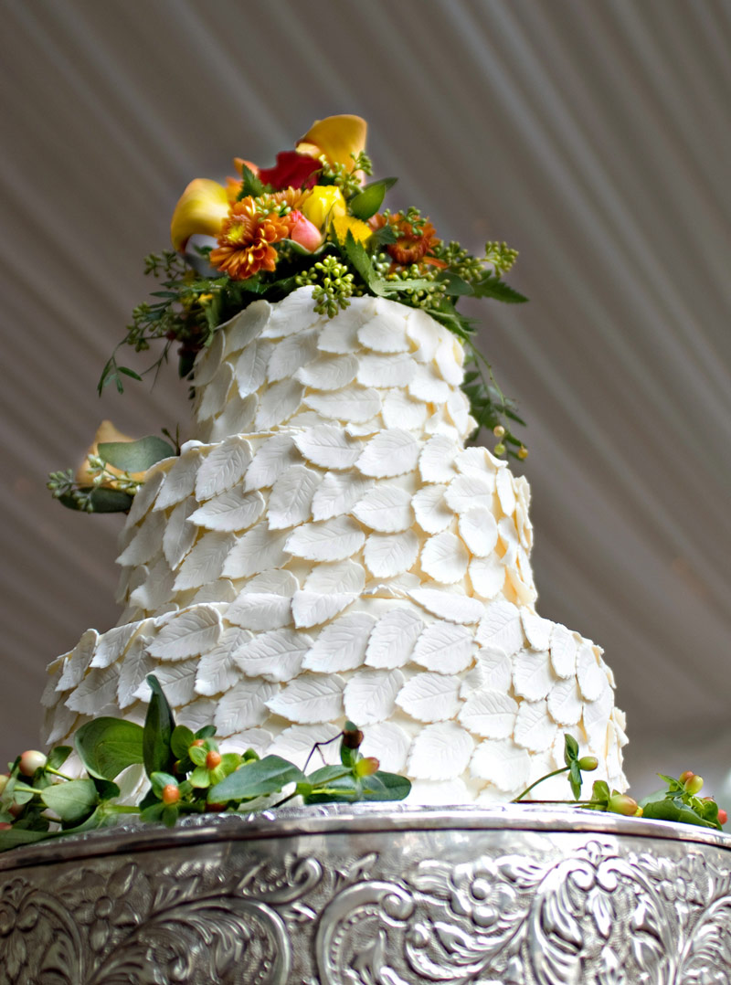 3 tier wedding cake with white leaves
