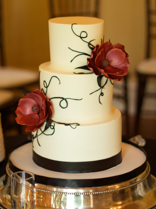 3 Tier Simple Round Wedding Cake with Two Red Flowers