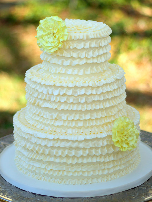 traditional cake with ruffle design and yellow flowers